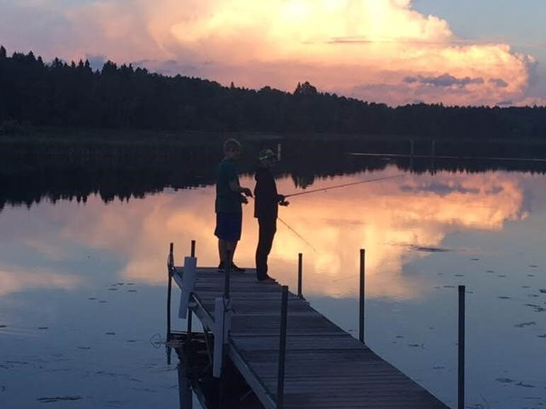 fishing at sunset on the dock at Cut Foot Sioux Resort