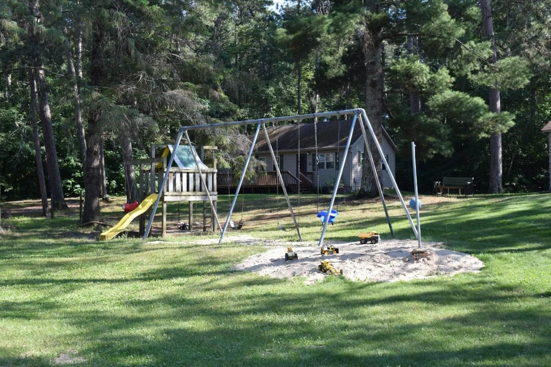 Playground swings at Cut Foot Sioux Resort